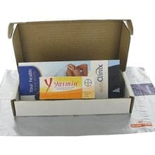 Box of Yasmin contraceptive tablets and a patient information leaflet